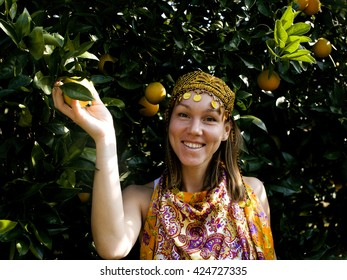 pretty islam woman in orange grove smiling, real muslim girl cheerful