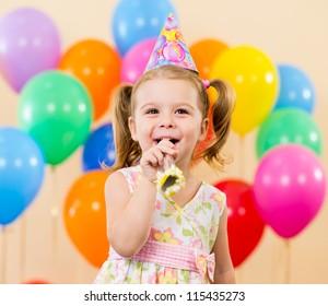 pretty joyful kid girl on birthday party