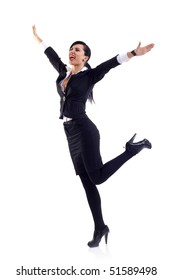 Pretty joyous business woman celebrating success over white background