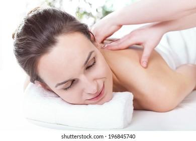 Pretty lady having nice neck massage, horizontal