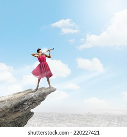 Pretty lady in red dress playing violin
