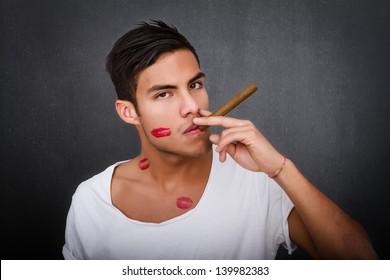 pretty latin play boy smokes cigar