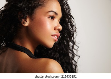 pretty latin woman's profile with curly hair