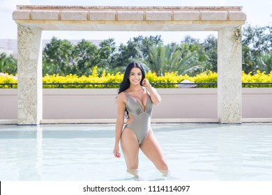 Pretty latina woman in swimming pool