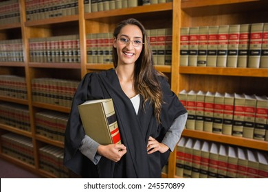 Pretty lawyer looking at camera in the law library at the university
