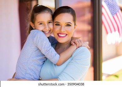 pretty little american girl hugging her mother