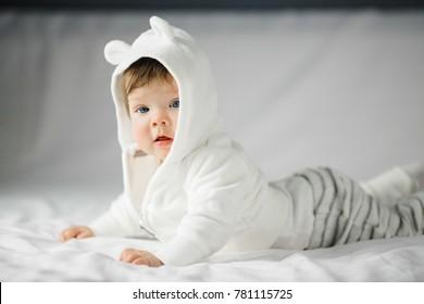 Pretty little baby in a hoody with ears