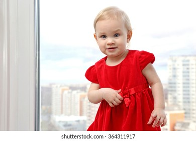 pretty little blonde girl in a red dress