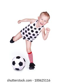 Pretty little boy hits a soccer ball over white background