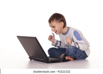pretty little boy with laptop on white