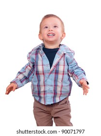 Pretty little boy looks up and smiles isolated on white background