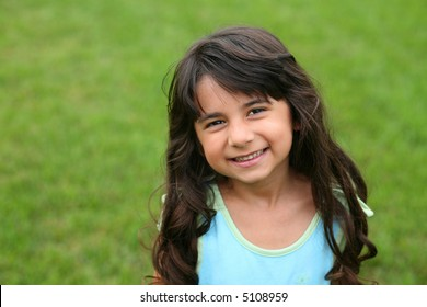 pretty little brunnete girl smiling
