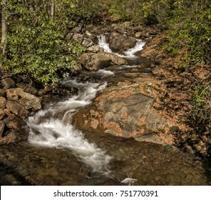 A pretty little cascade in western North Carolina. Seen here with autumn colors  in October.