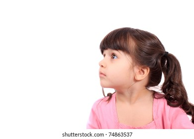 Pretty little four year old girl looking to the side and up, with copy space
