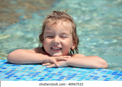pretty little girl bathe in pool, closed eyes