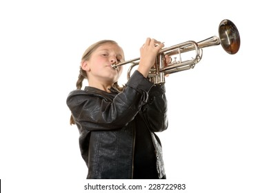 a pretty little girl with a black jacket plays the trumpet on white background