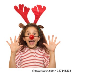 Pretty little girl with Christmas antlers on her head and red Rudolph the reindeer nose screaming excitedly isolated copyspace party celebration x-mas new year family emotions costume Santa Claus