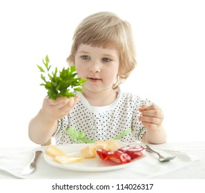 Pretty little girl demonstrating fresh parsley; healthy eating for a baby