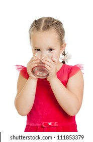 pretty little girl drinking water from glass over white background