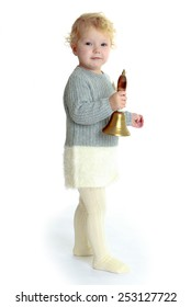 pretty little girl holding a bell.Isolated on white.