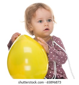 A pretty little girl is holding a big yellow balloon; isolated on the white background
