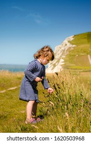 pretty little girl on vacation on the coast in northern France