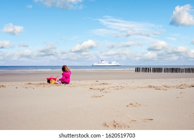 pretty little girl on vacation on the beach of Calais in France