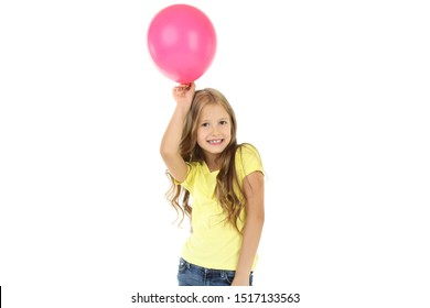 Pretty little girl with pink balloon on white background