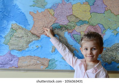 Pretty little girl pointing at the map