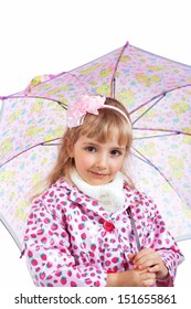 Pretty little girl in raincoat with pink umbrella