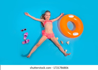 Pretty little girl relaxes with inflatable circle. Summer travel concept.