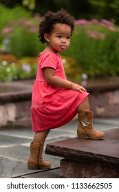 Pretty little girl walking up steps.