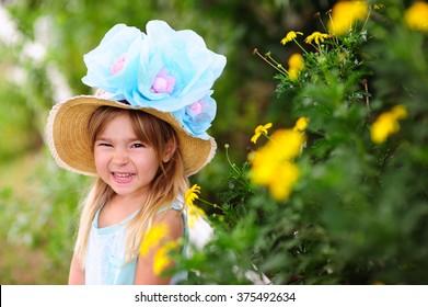 Pretty little girl wearing Easter Hat outdoor