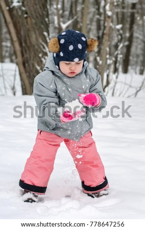 a78e90d6f Pretty Little Girl Winter Clothes Stands Stock Photo (Edit Now ...