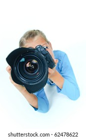 Pretty lovely girl with a camera big lens. In the studio