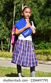 Pretty Minority Girl Student Deciding With Books