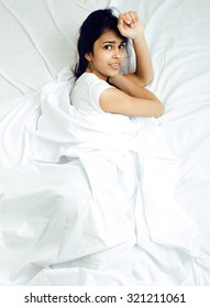 pretty mixed race brunette woman in bed