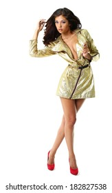 Pretty model in gold fashionable raincoat posing