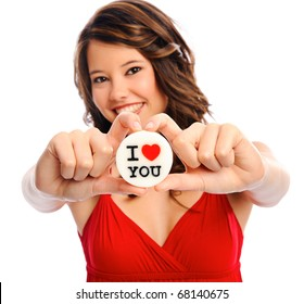 Pretty model holds a 'i love you' candle in studio, selective focus on message