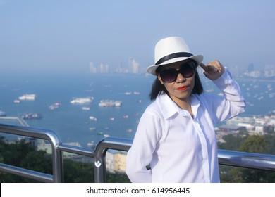 Pretty model woman posing on viewpiont of Pattaya, Thailand
