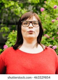 pretty modern mature fat woman outside wearing glasses, emotional posing happy lifestyle people