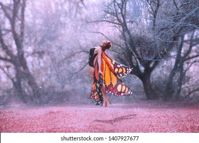 Pretty Monarch butterfly levitation, with huge wings. Coast with bliss on the face. Gentle soaring in the air, purple soul of nature aspire to heaven. Young woman with slim body in fairy style costume