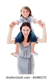 Pretty mother giving her daughter piggyback ride against a white background