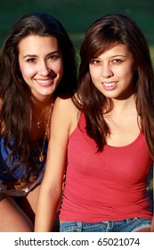 Pretty multicultural college teenagers and roommates enjoying university campus life.