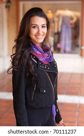Pretty multicultural young woman at an outdoor shopping mall.