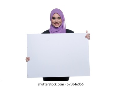 A pretty muslim businesswoman wearing hijab, suit and spectacle holding a blank white board isolated on white background