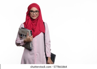 Pretty muslim female student with hijab is carrying books and a slingbag isolated on white background
