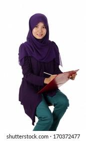 Pretty muslim woman model holding a board