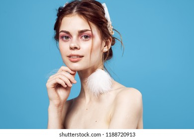 pretty nude woman with fluffy earrings