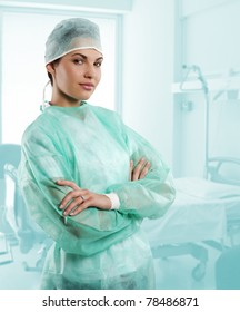 pretty nurse wearing a surgery dress with cap isolated over white looking in camera